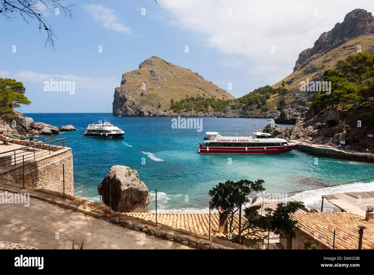 Spain, Majorca, View of Ferries in bay of Sa Calobra - Stock Image