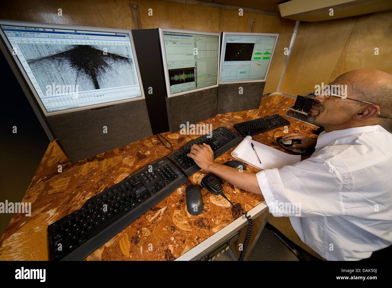 Inside truck of oil exploration seismic monitoring mobile base station, Mali, West Africa - Stock Image
