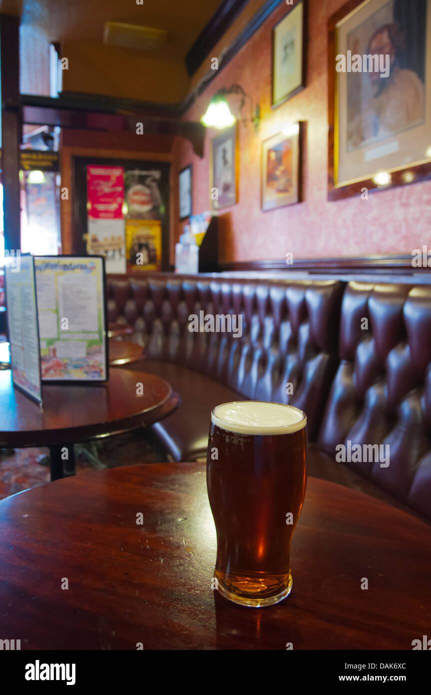 Pint of bitter beer Fitzroy tavern pub London England Britain UK Europe - Stock Image
