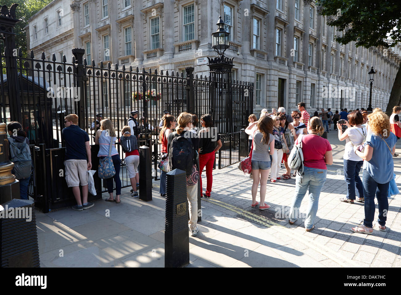 tourists outside the security gates of downing street london, england uk Stock Photo