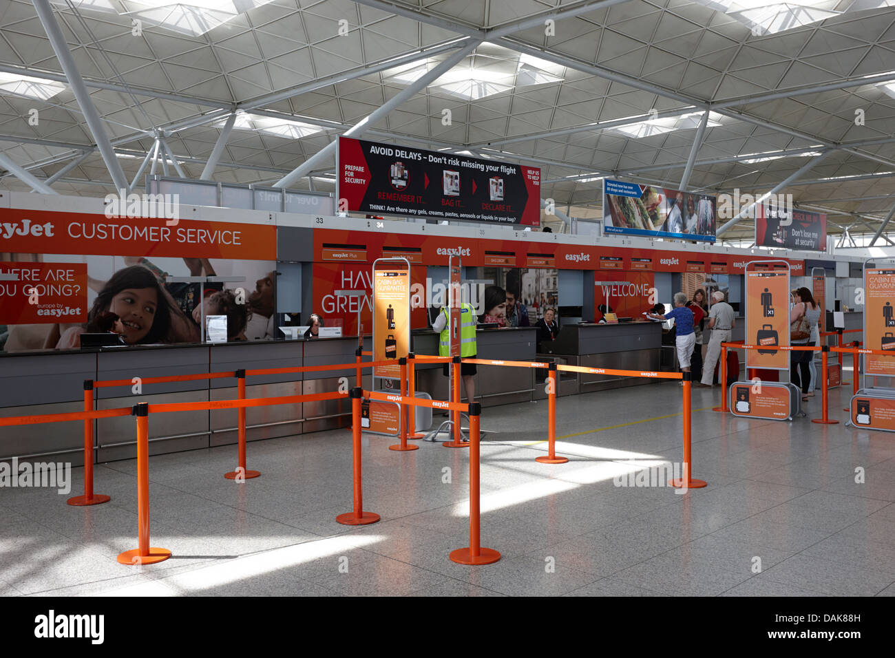easyjet check-in desks london stansted airport essex, england uk - Stock Image