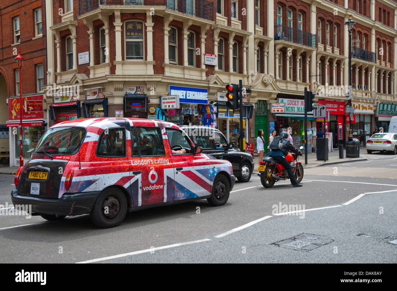 Traffic in Shaftesbury Avenue street central London England Britain UK Europe - Stock Image