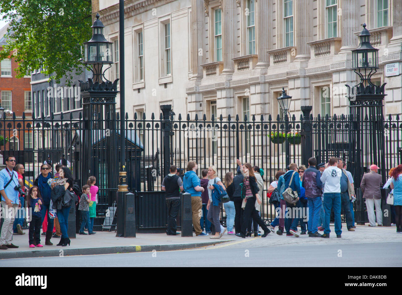 People in front of the gates of Downing Street Prime Ministers residence London England Britain UK Europe - Stock Image