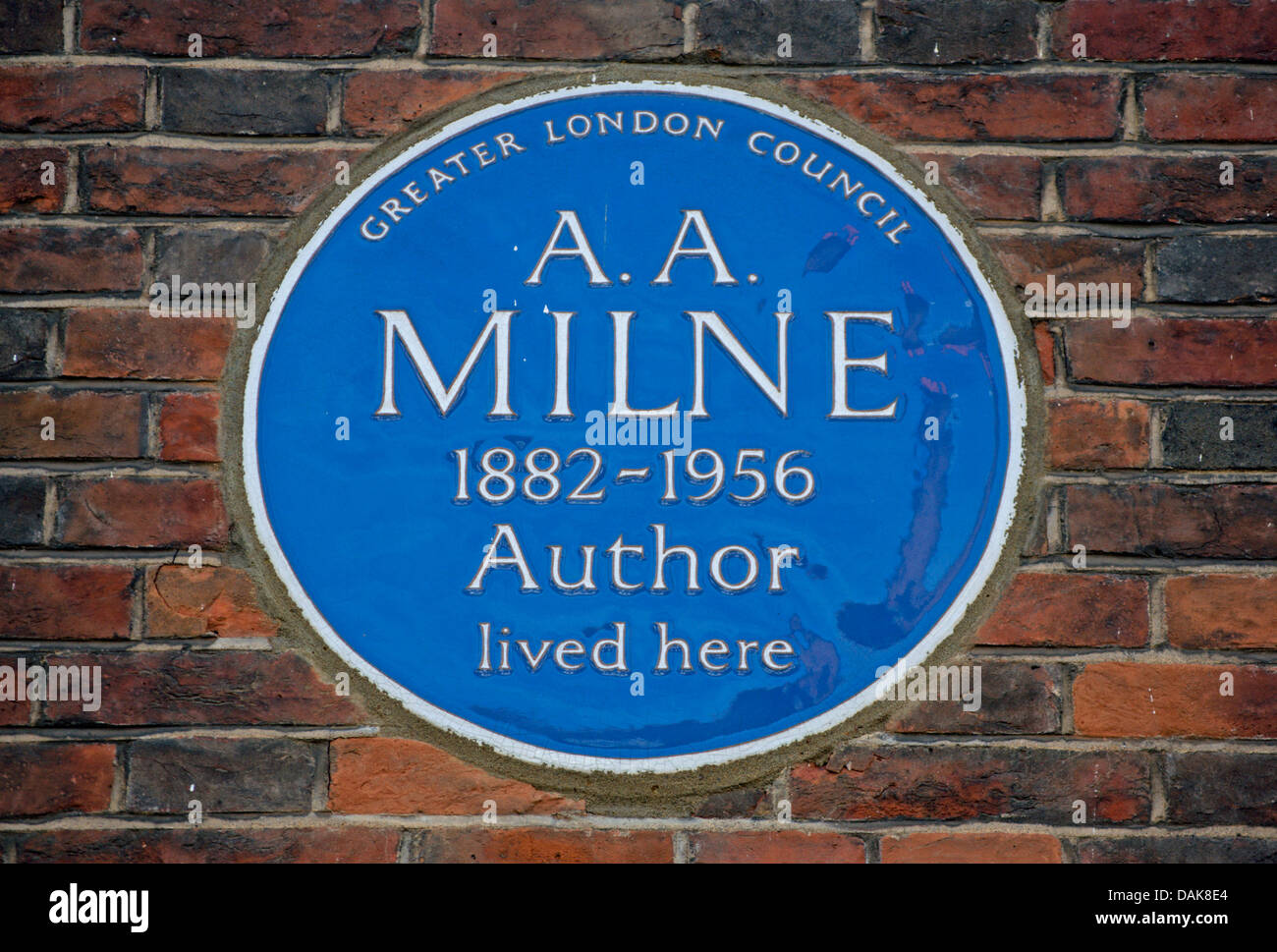 greater london council blue plaque marking a home of auther a.a. milne, chelsea, london, england - Stock Image