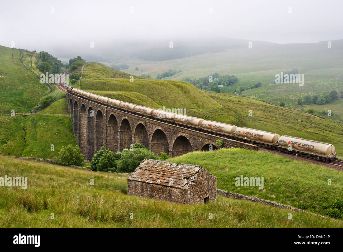 Train of cement waggons crosses Artengill viaduct, Dentdale, Settle to Carlisle railway, North Yorkshire, UK - Stock Image