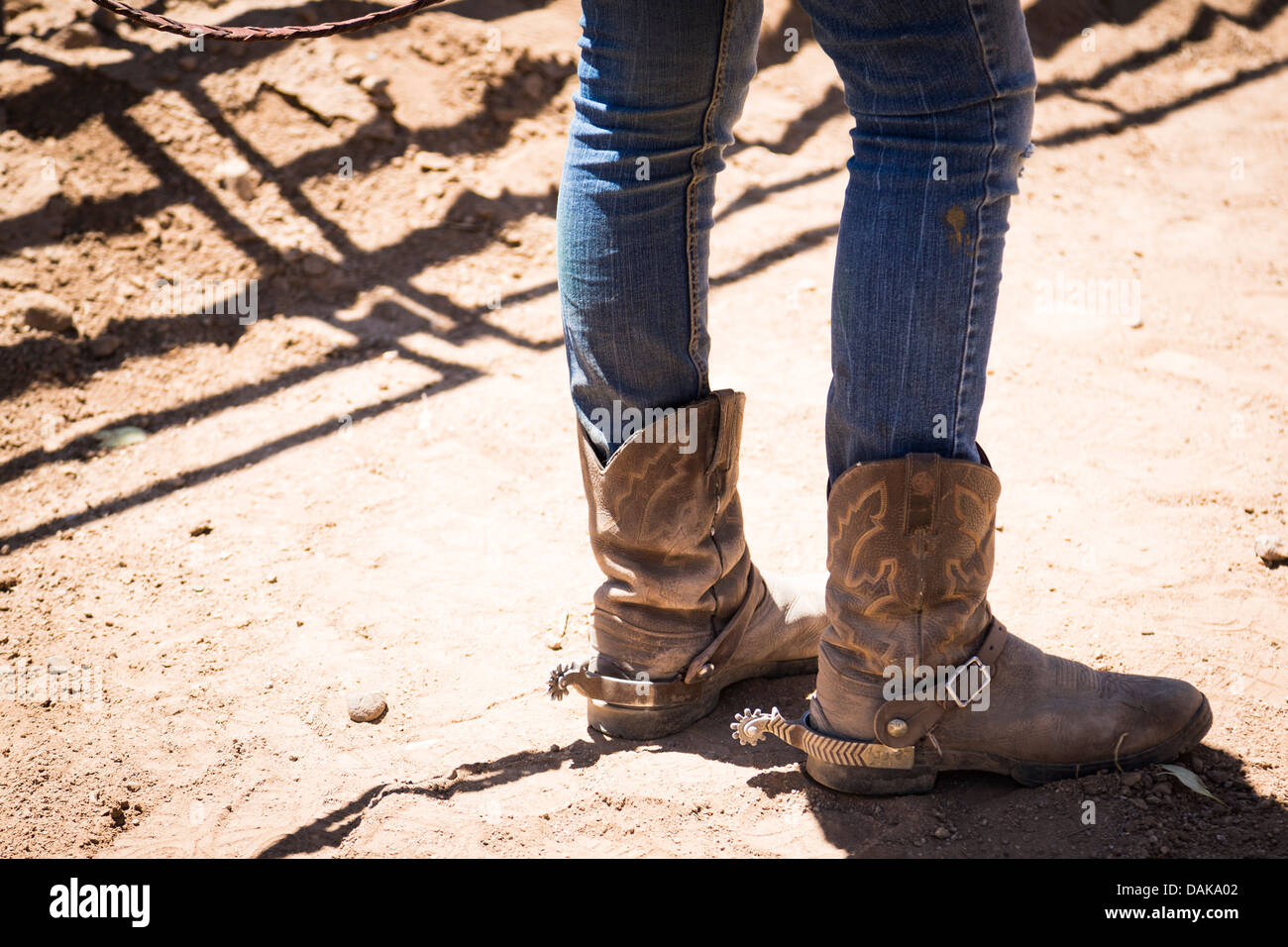 Legs Of A Young Woman Wearing Cowgirl Boots With Spurs Stock Photo