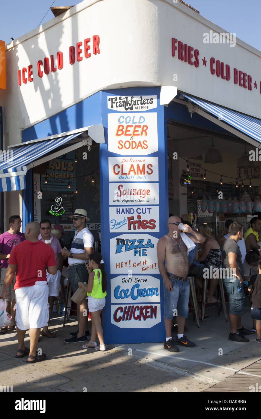 Restaurant food menu on the boardwalk at Coney Island with tasty but not so healthy choices. - Stock Image