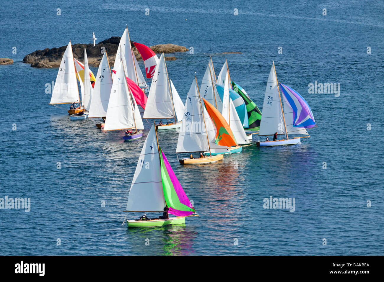 A flotilla of yachts sail out of Fowey's Estuary - Stock Image