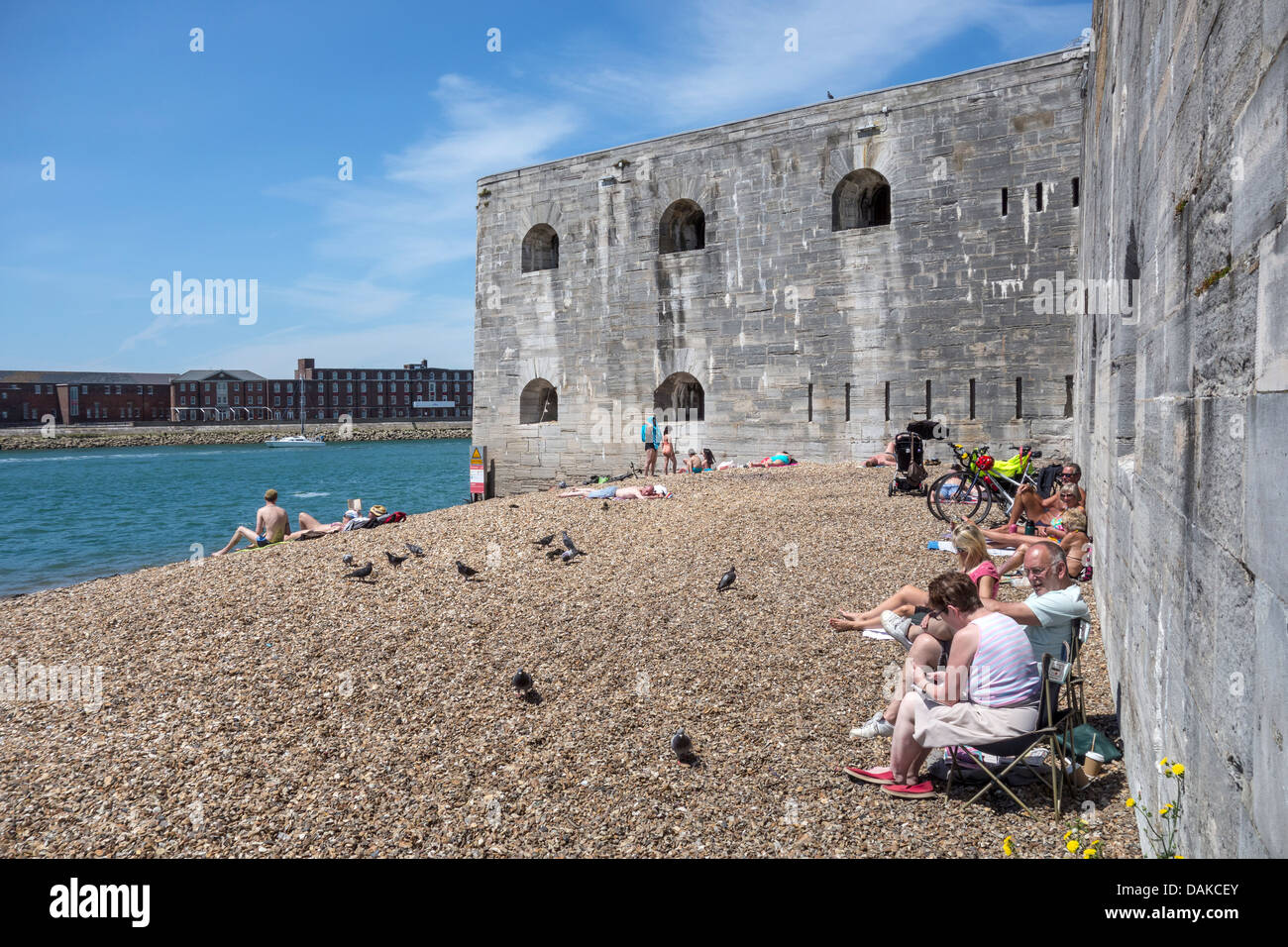 Old Portsmouth Beach and Fortifications Sunbathing Sunbathers - Stock Image