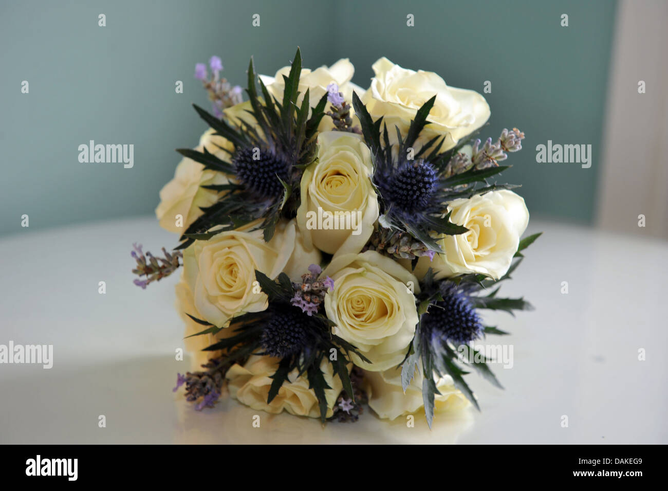 Wedding bouquet of white roses and purple heather stock photo wedding bouquet of white roses and purple heather izmirmasajfo