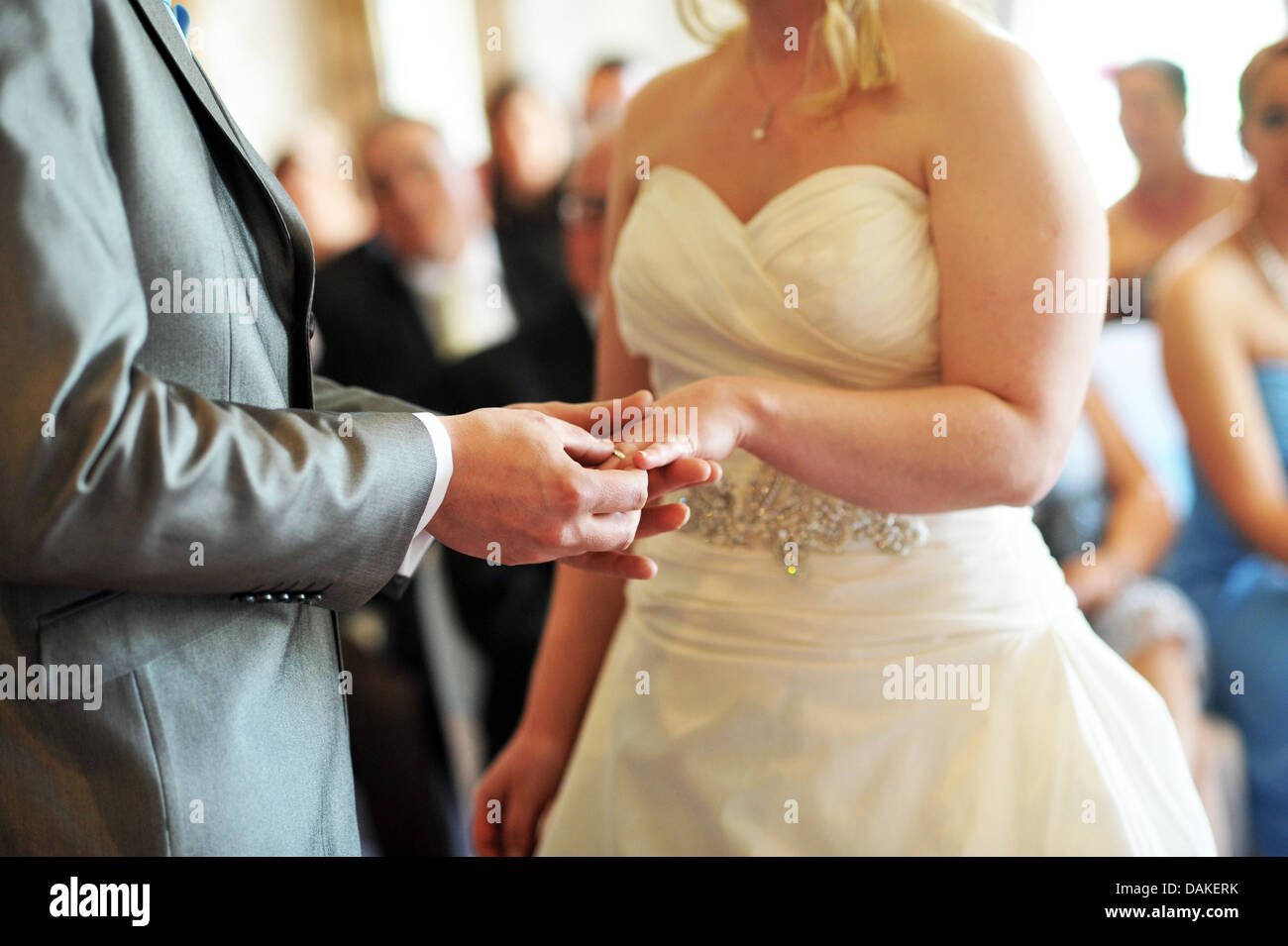 Bride and groom exchange wedding rings during the wedding ceremony. Stock Photo