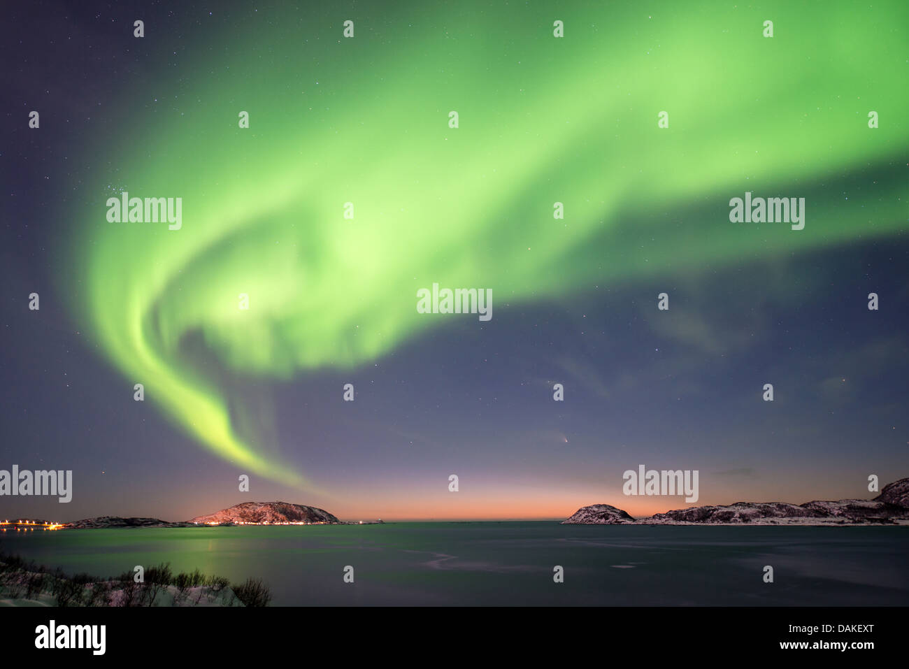 aurora borealis in dusk over island Kvaloeya, Norway, Troms - Stock Image