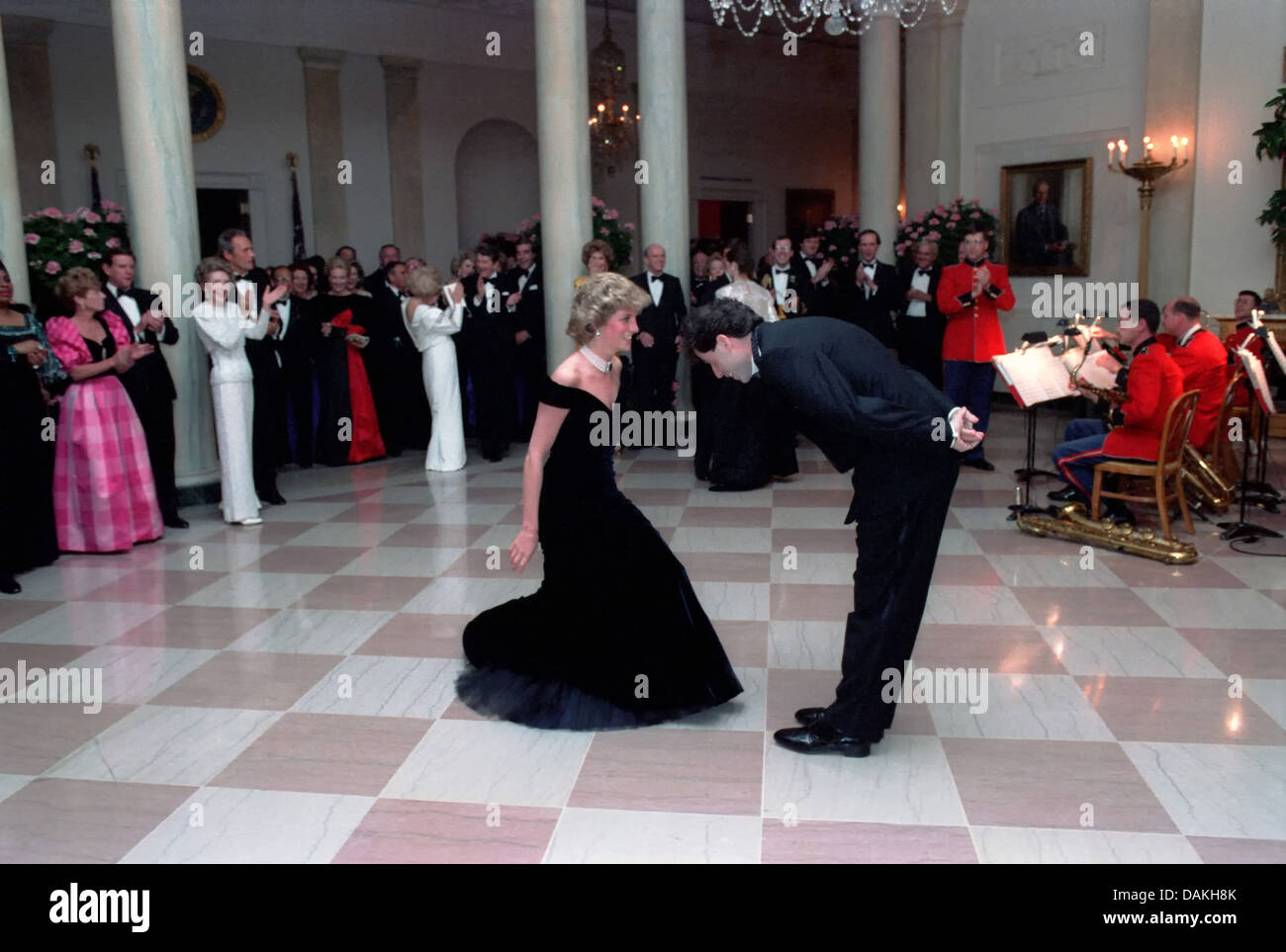 Actor John Travolta bows to Diana, Princess of Wales after their dance during a White House Gala Dinner November - Stock Image