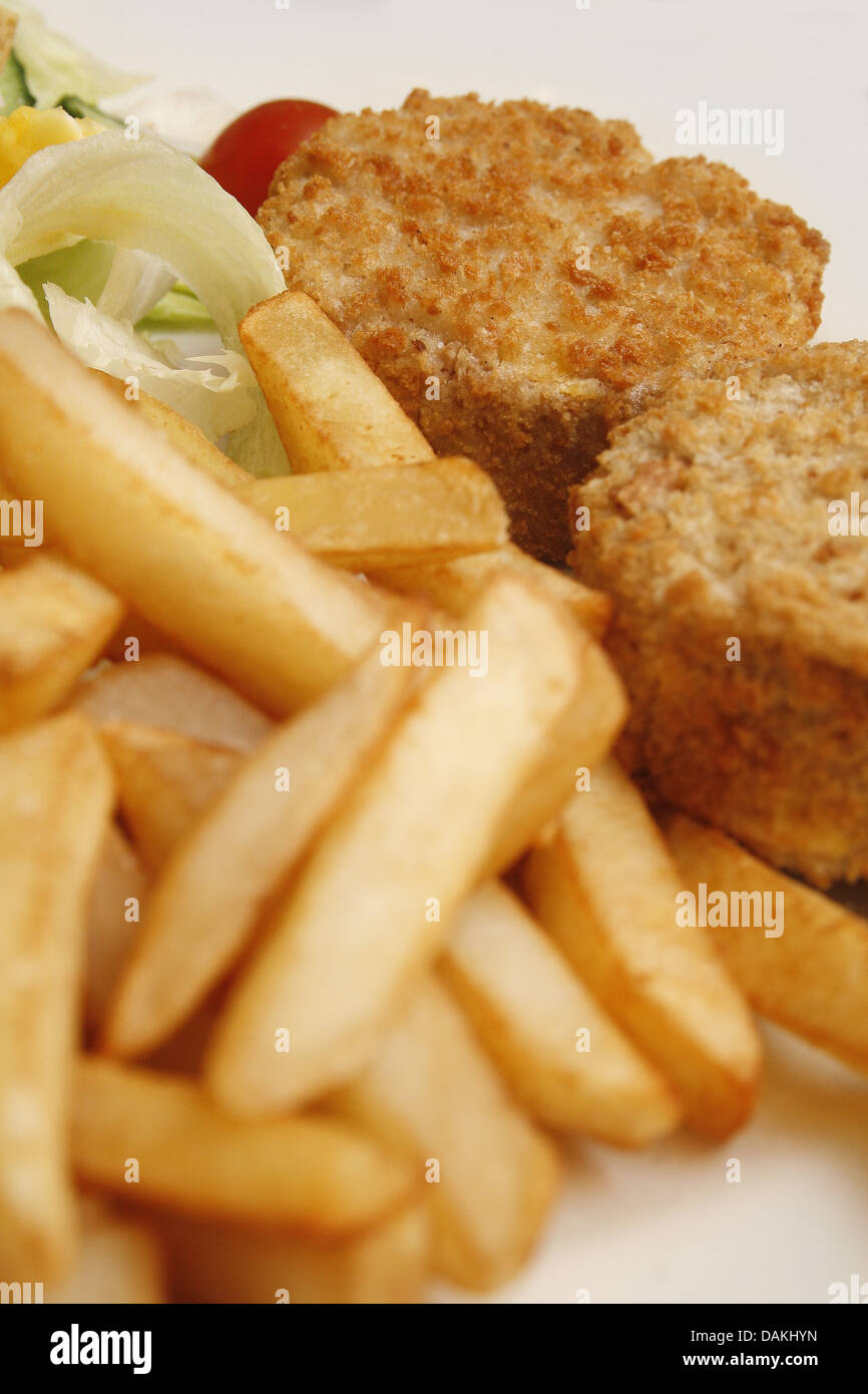 tuna style quorn bakes served with chips and salad - Stock Image