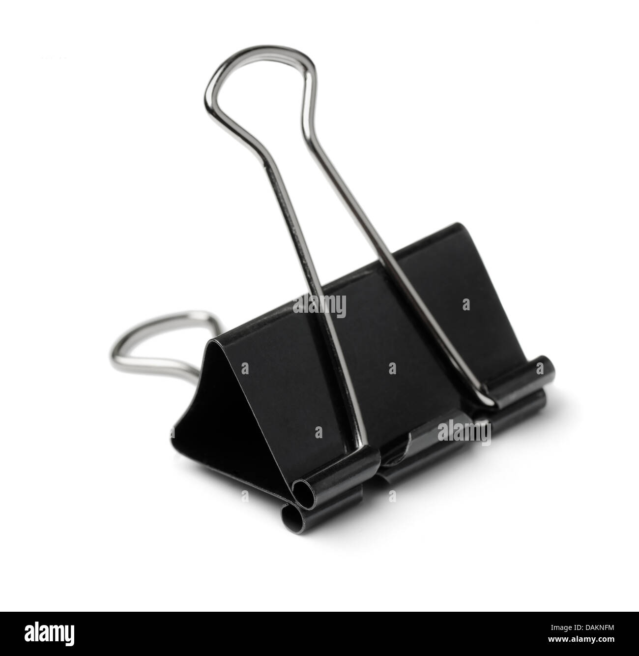 Black paper binder clip isolated on white - Stock Image