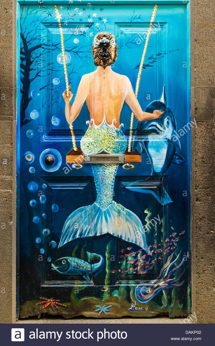 Door artwork in Madeira showing a mermaid sitting on a swing & Door artwork in Madeira showing a mermaid sitting on a swing Stock ...