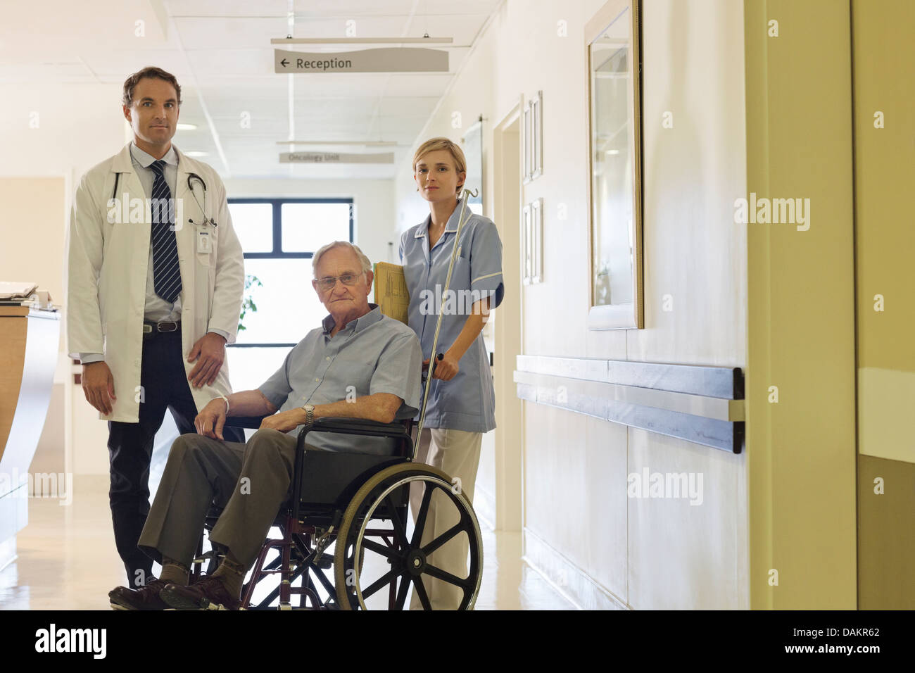 Doctor and nurse with older patient in hospital - Stock Image
