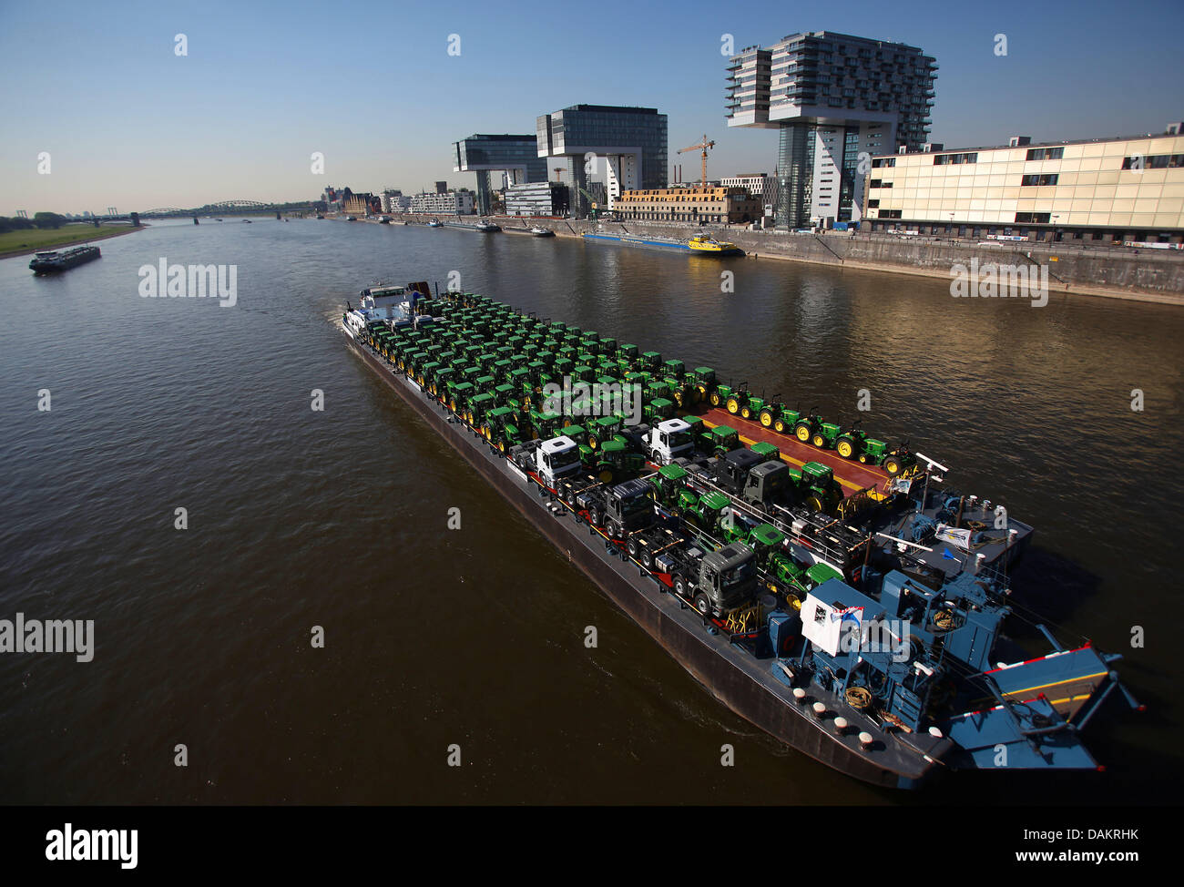 A ship transporting tractors is visible at the Rhin river in Cologne