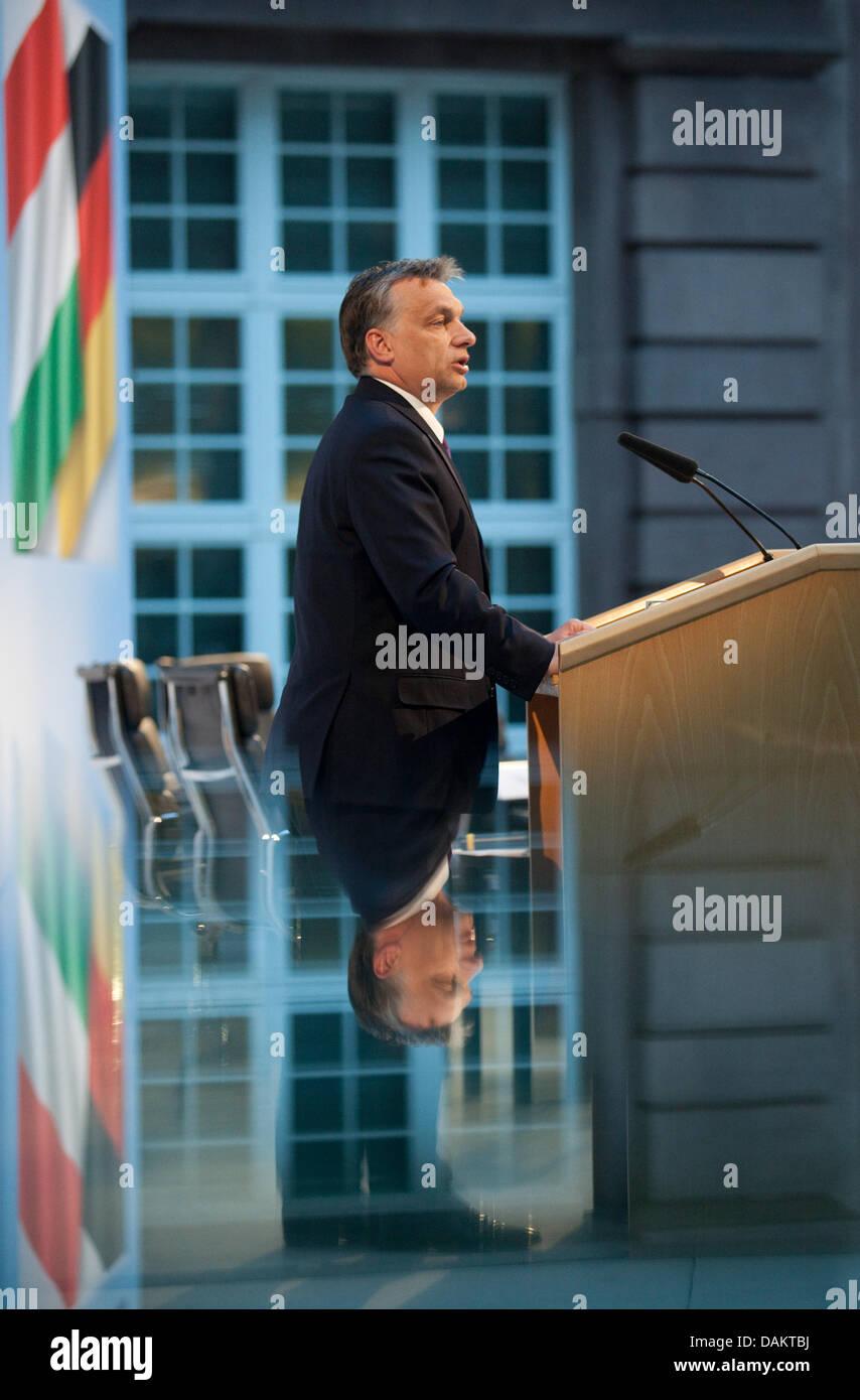 Hungarian Prime Minister Viktor Orban speaks in Berlin, Germany, 05 May 2011. Deutsche Bank CEO Josef Ackermann Stock Photo