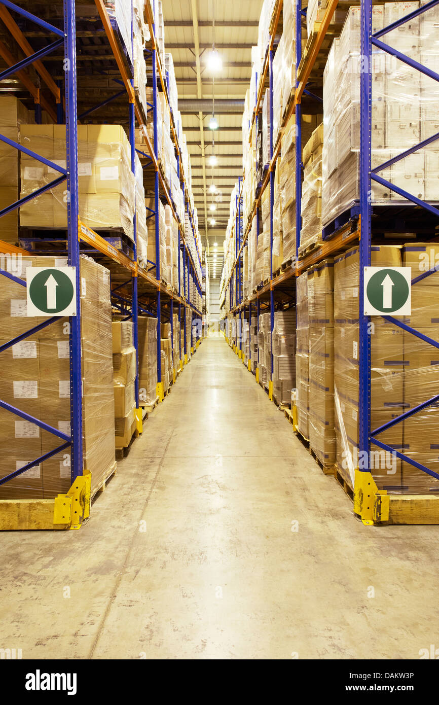 Pallets of boxes in warehouse - Stock Image