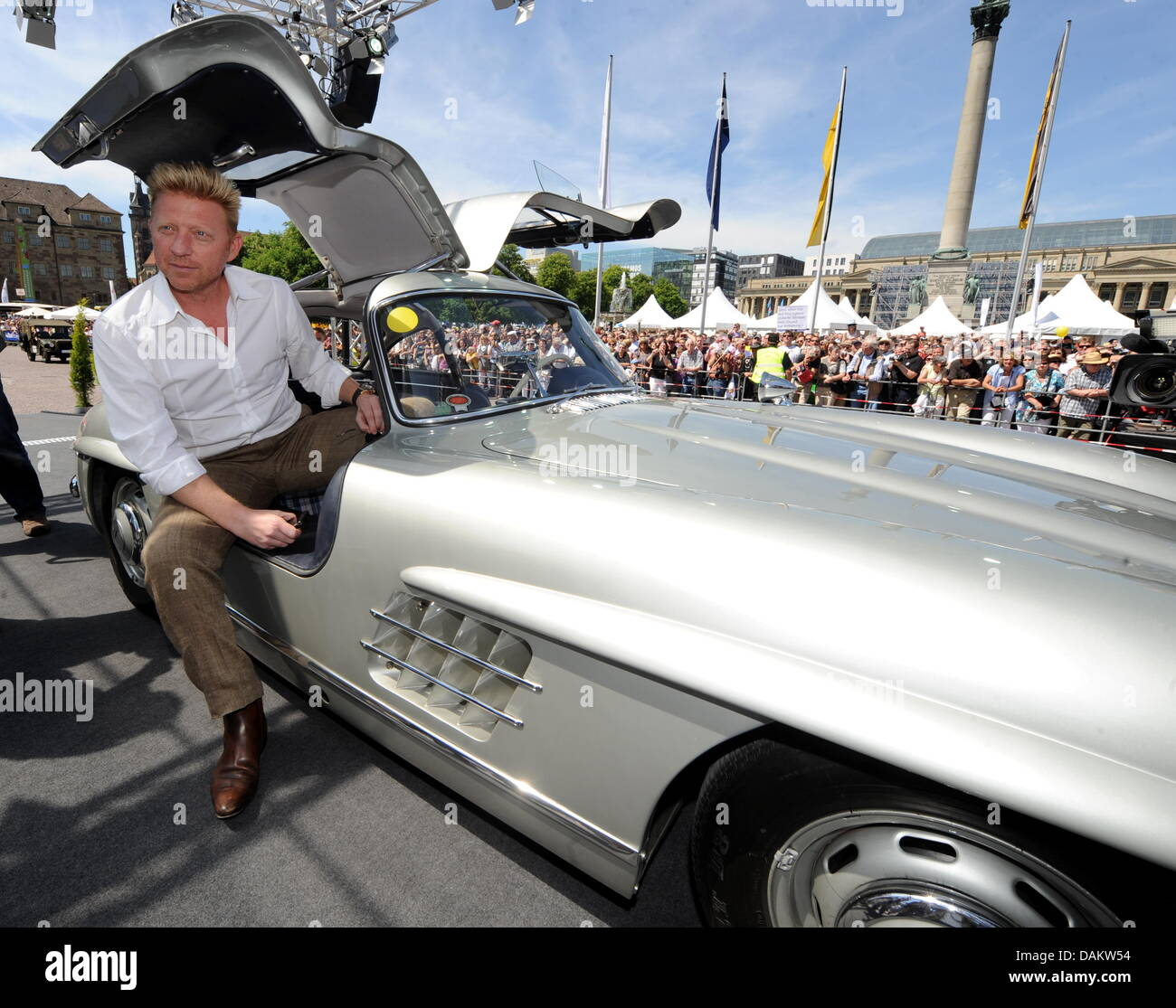 Former tennis pro Boris Becker in a Mercedes gull-wing door classic