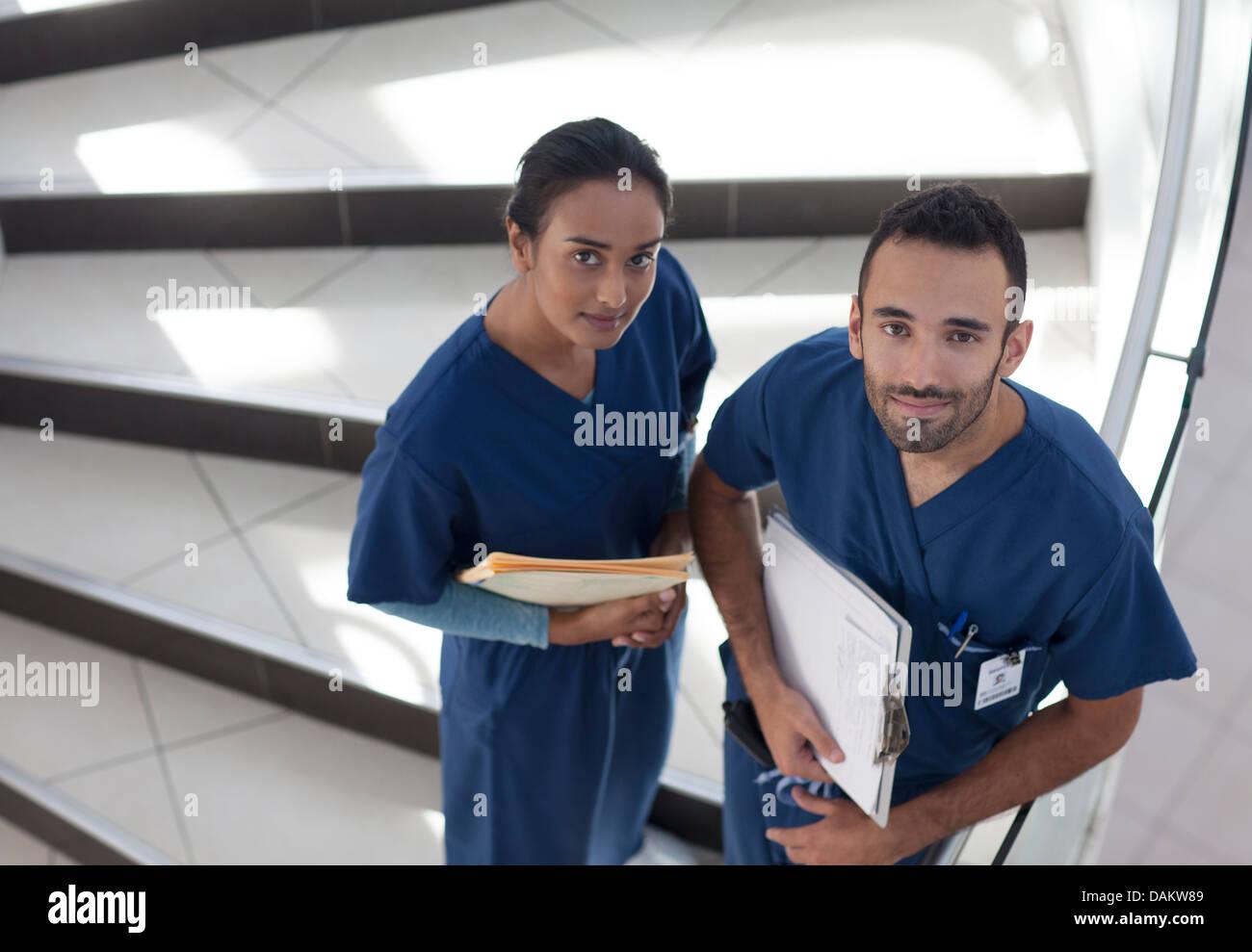 Nurses standing on hospital steps - Stock Image