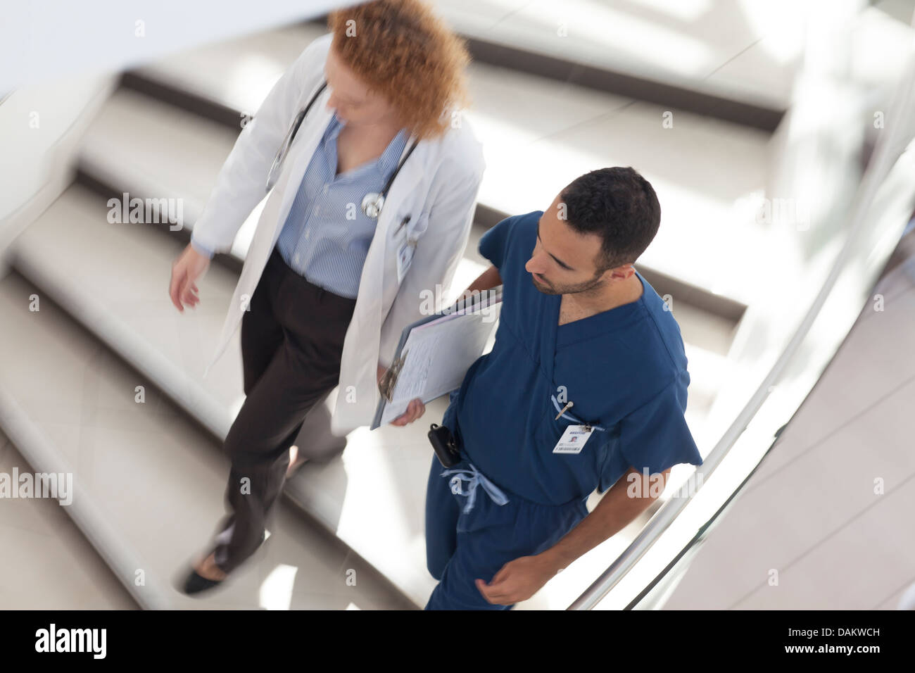 Doctor and nurse walking on hospital steps Stock Photo