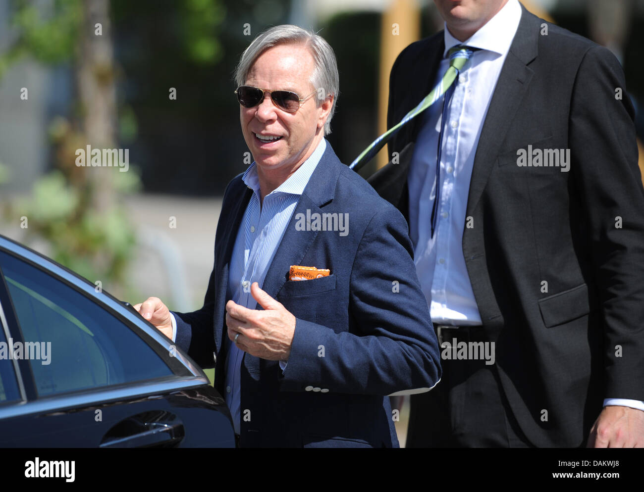 us fashion designer tommy hilfiger gets in his car after his visit to stock photo 58214864 alamy. Black Bedroom Furniture Sets. Home Design Ideas