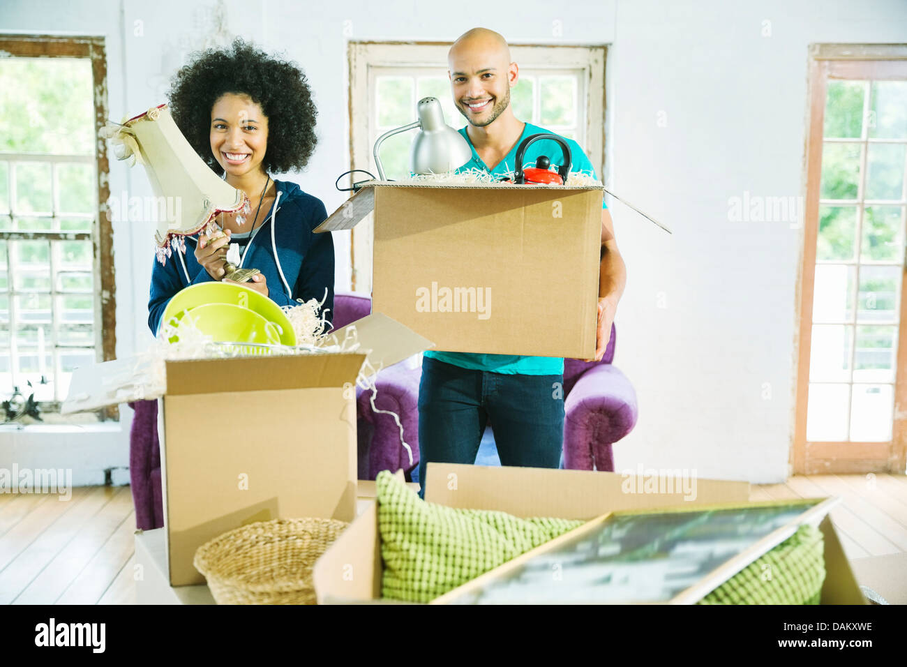 Couple unpacking boxes in new home Stock Photo