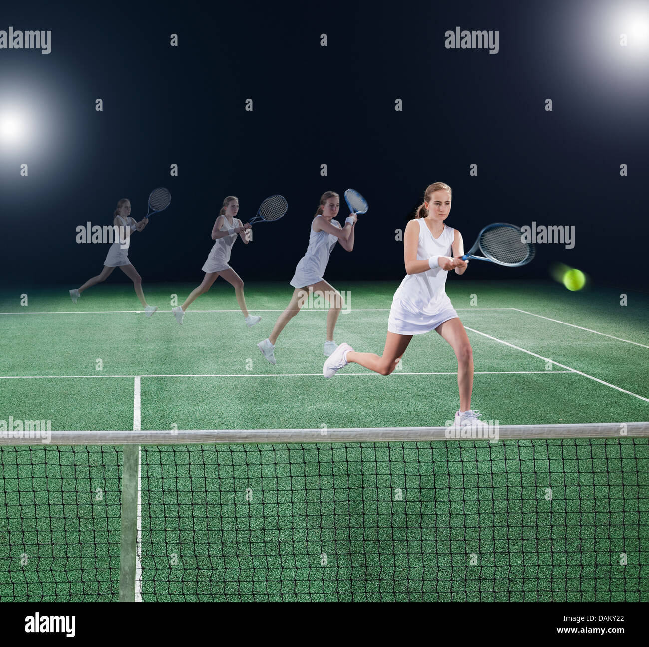 Multiple exposure of tennis player hitting ball on court - Stock Image