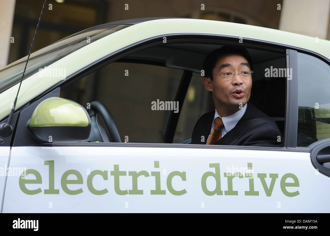 During the handover new economic minister Philipp Roesler sits inside an electric car at the Economic Ministry in - Stock Image