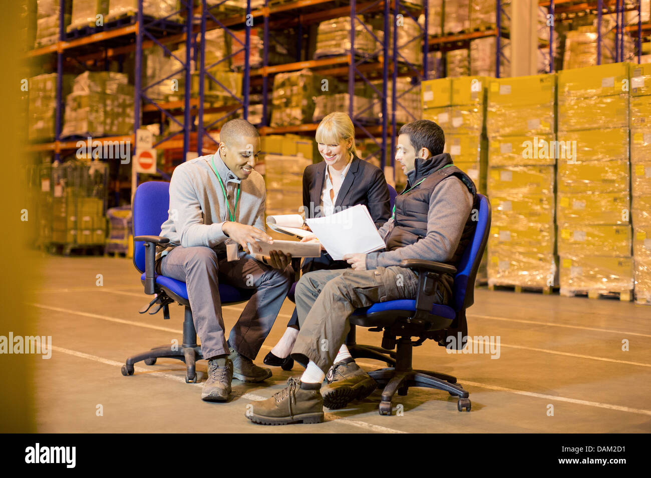 Business people talking in warehouse - Stock Image