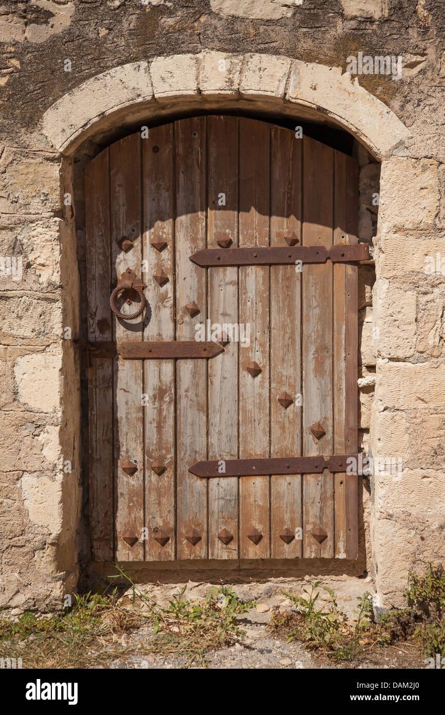 Old Wooden Door With Metal Decor In Monastery Touplu Crete Greece