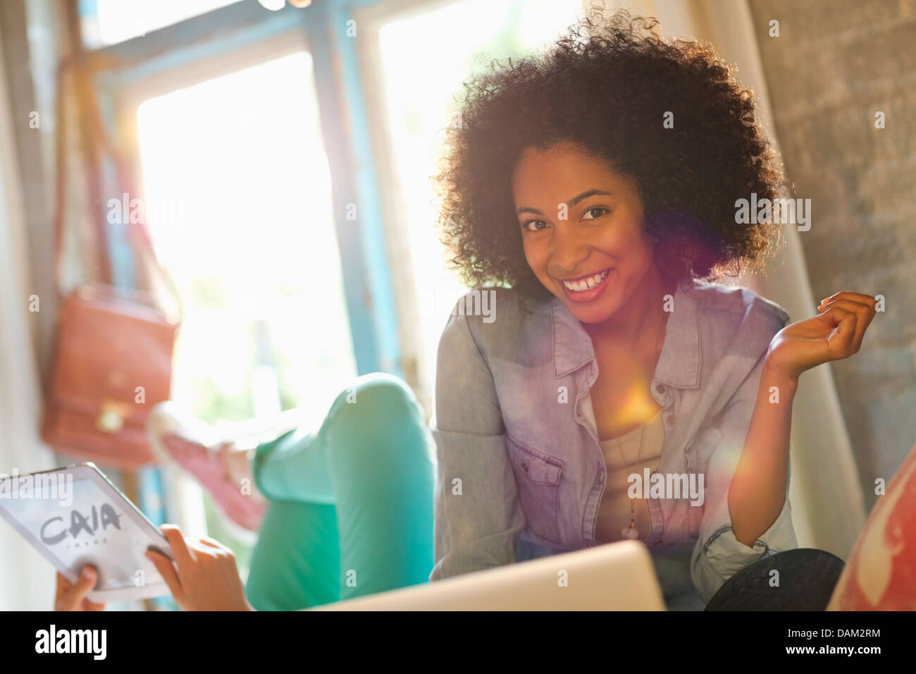 Woman smiling in bedroom - Stock Image