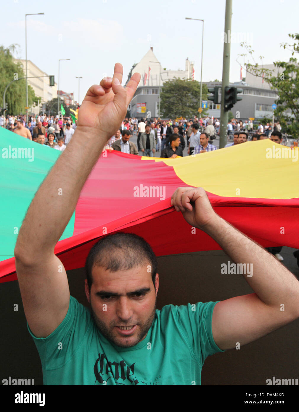 Demonstrators carry a Kurdish flag during demonstration in Berlin, Germany, 21 May 2011. Around 300 people - Stock Image
