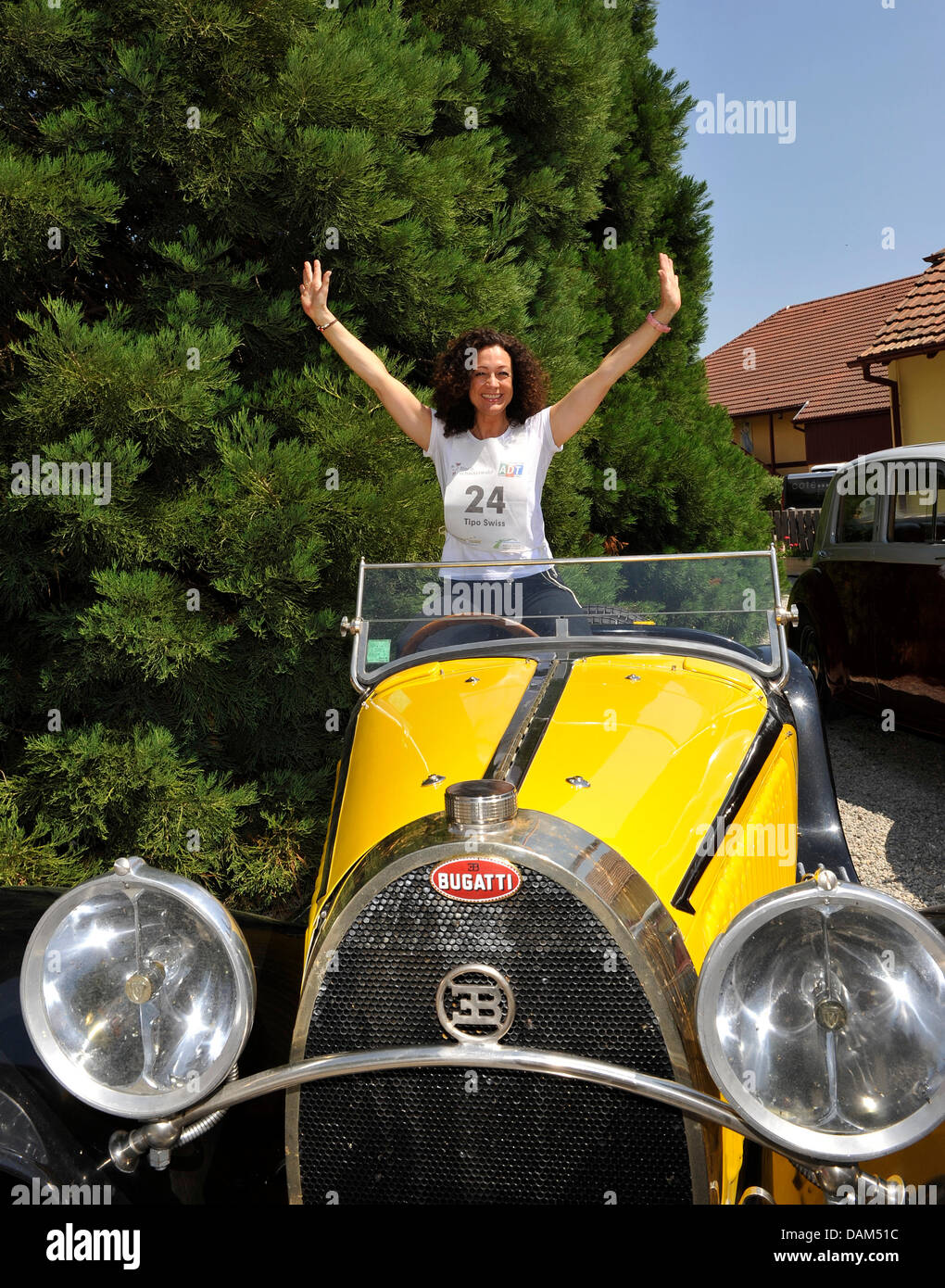 Actress Barbara Wussow waves out of an opld Bugatti at this year's Big Border Traffic ('Der Große Grenzverkehr - Stock Image