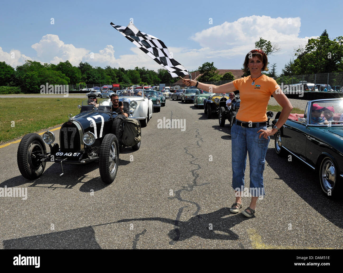 Caroline Bugatti, granddaughter of automobile producer Bugatti, waves the start flag for The Big Border Traffic - Stock Image