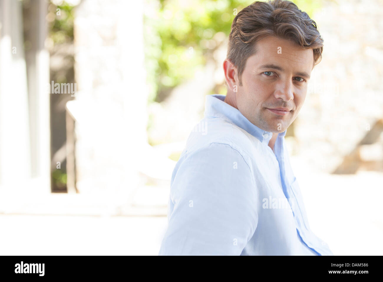 Man smiling outdoors - Stock Image