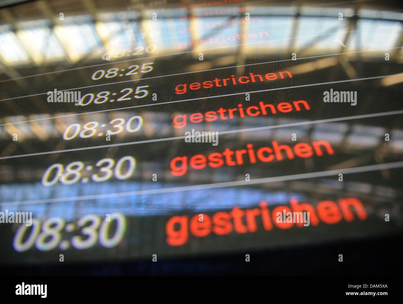 A destination board informs passengers on cancelled flights at the airport in Hamburg, Germany, 25 May 2011. An - Stock Image