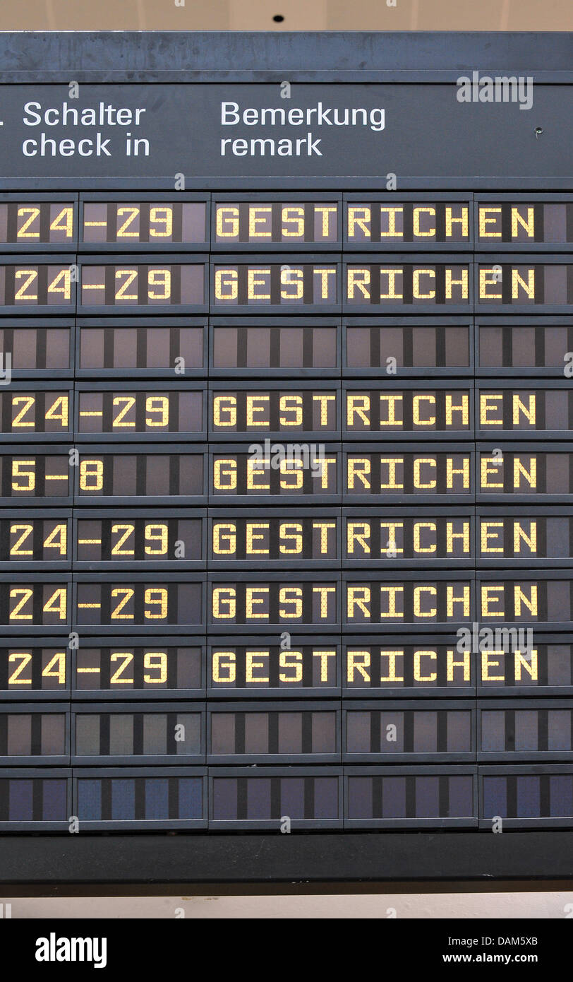 A destination board informs passengers on cancelled flights at the airport in Bremen, Germany, 25 May 2011. An ash - Stock Image