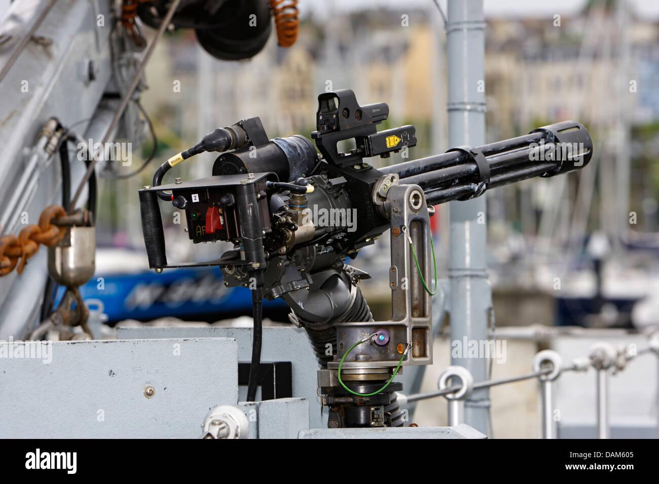 minigun mounted as close in weapons protection against small boat attacks british royal navy warship - Stock Image