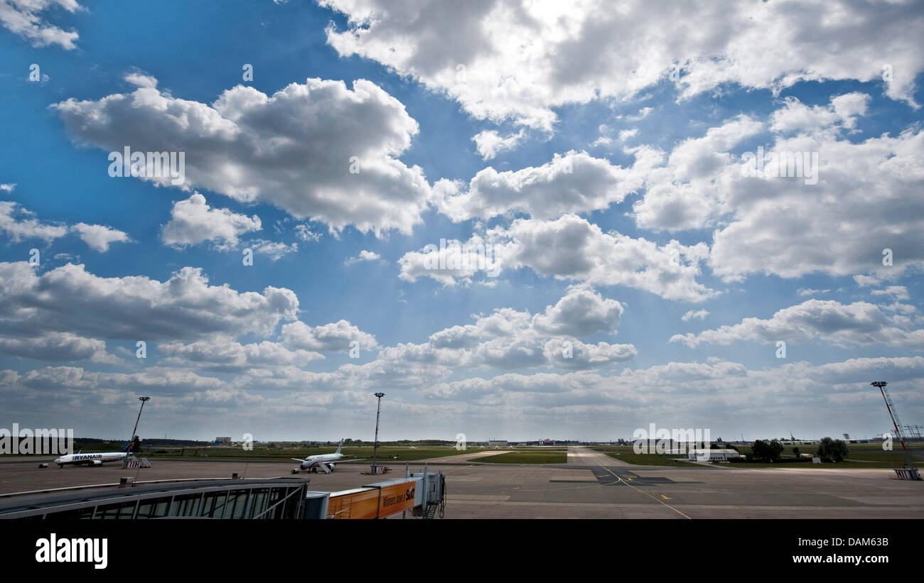 A cloudy sky is visible above the runway of the airport Berlin-Schoenefeld in Berlin, Germany, 25 May 2011. An ash - Stock Image