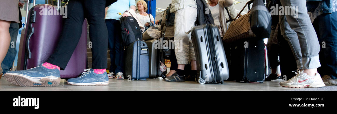 A group of passengers wait at a departure lounge of the airport Berlin-Schoenefeld in Berlin, Germany, 25 May 2011. - Stock Image