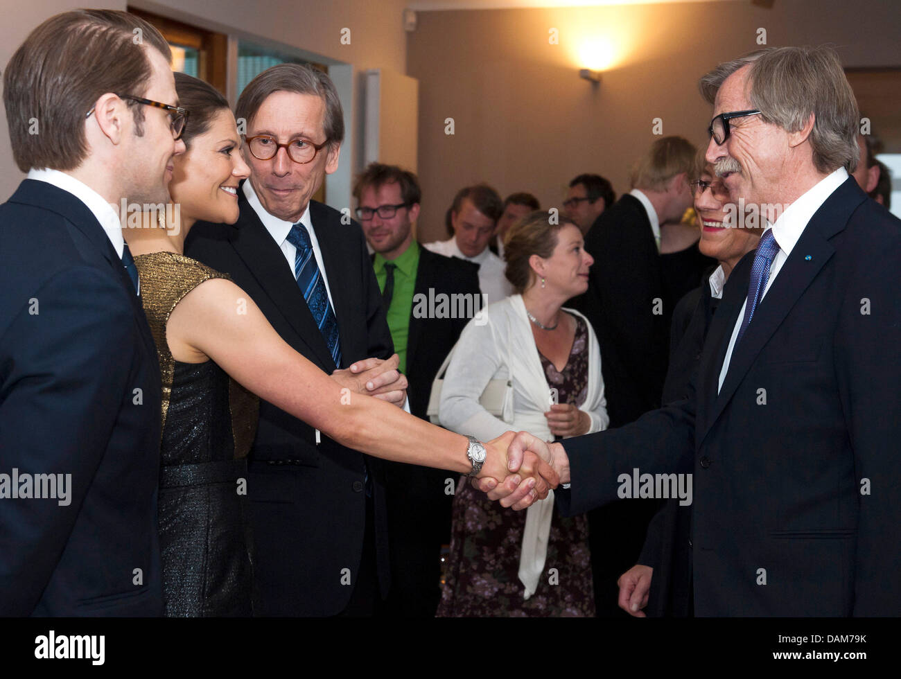 Swedish Princess Victoria (2-l) and her husband Daniel (l) stand next to the Swedish embassador in Germany, Staffan - Stock Image