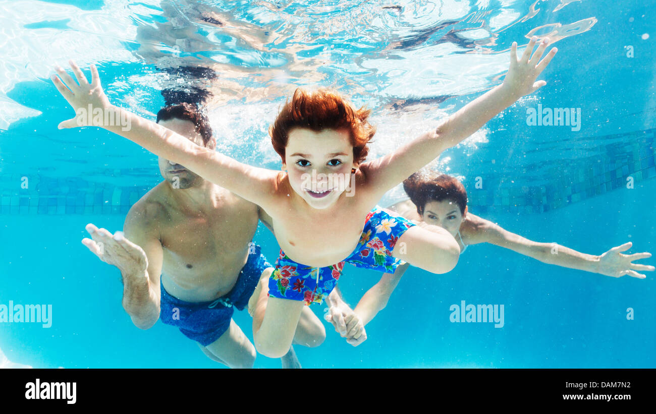 Family swimming in pool - Stock Image