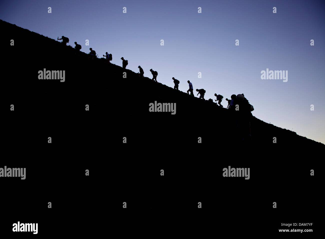 People climbing, hikers in trekking activity on Stromboli, active volcano in Eolie, Aeolian islands, Sicily, Sicilia, - Stock Image