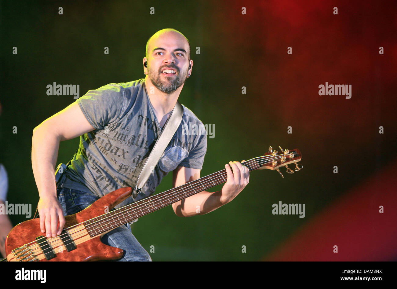 Sunrise Avenue's bass guitar player Raul Ruutu fromFinland performs at the Schlossgraben festival in Darmstadt,Germany, - Stock Image