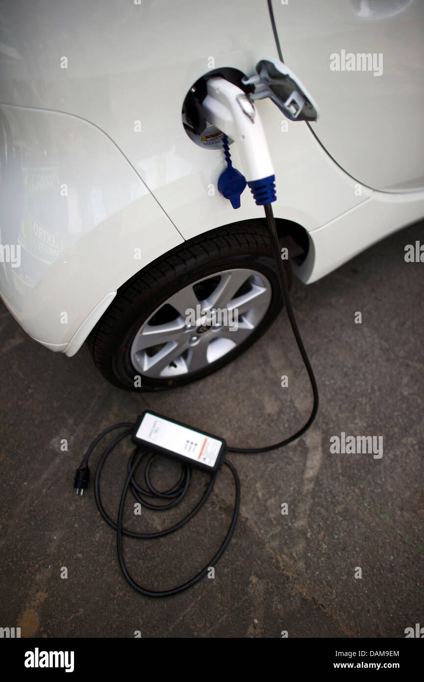 A charging cable sticks into a new electric car from DREWAG Public Utilities GmbH in Dresden,Germany, 26 May - Stock Image