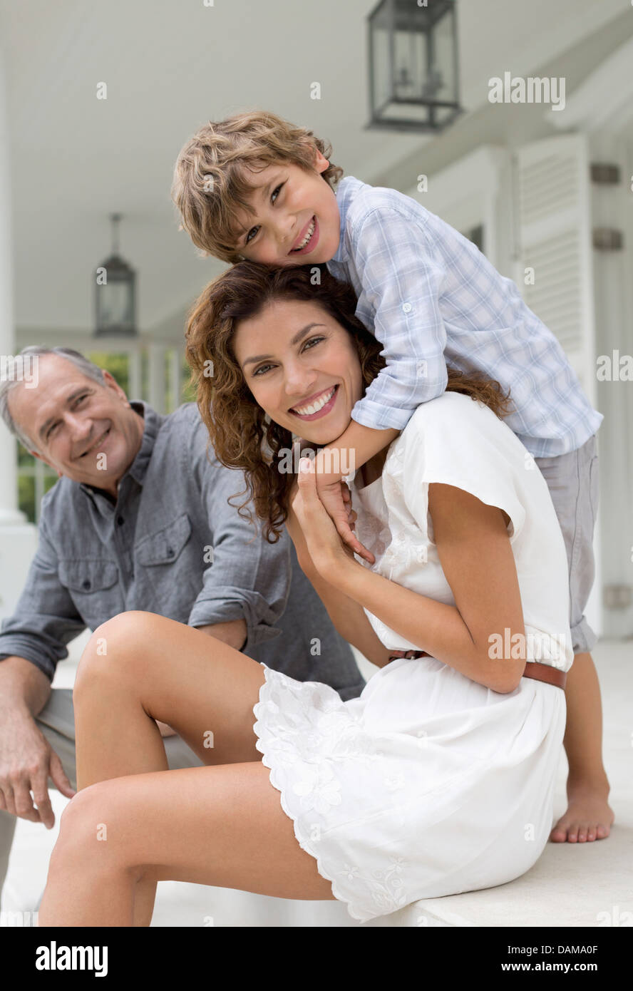 Mother and son smiling on porch - Stock Image