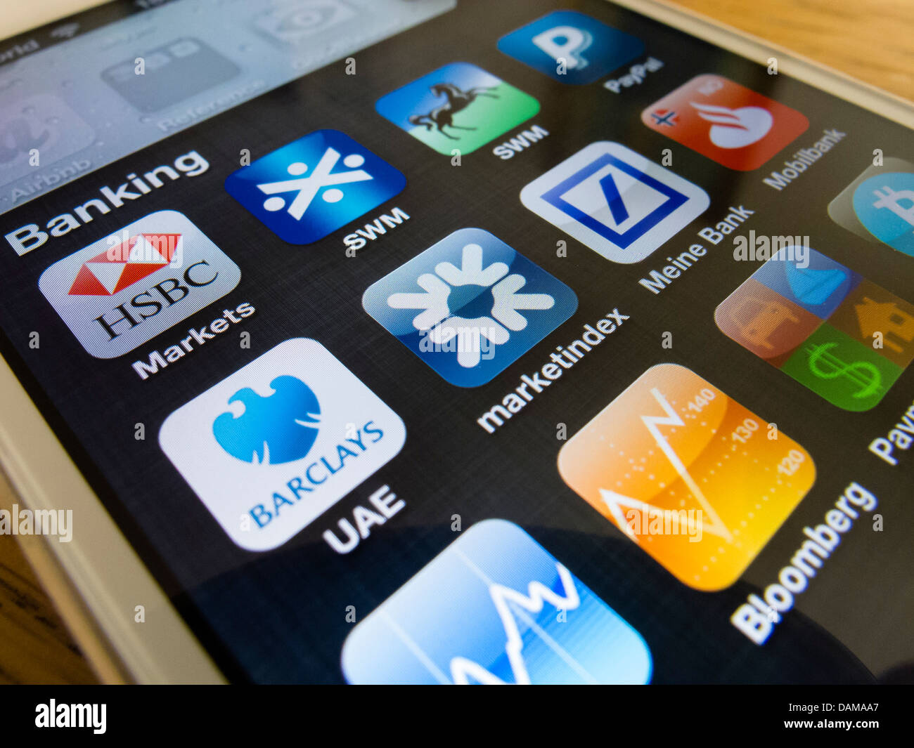 detail of iPhone 5 with many banking apps - Stock Image
